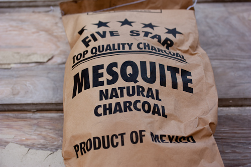 This exact brand might be hard to find, but there are mesquite and hardwood varieties in most grocery stores.