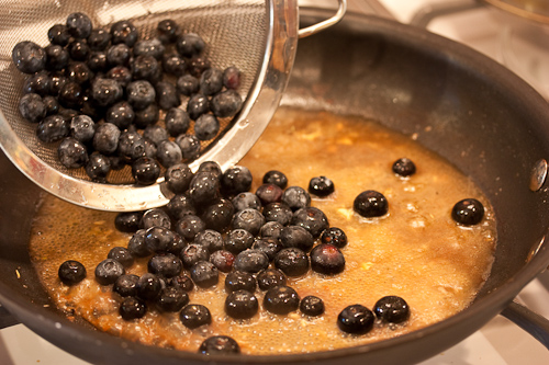 Add the berries to the burbling pan juices