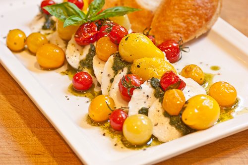 The heat of the tomatoes softens the fresh mozzarella