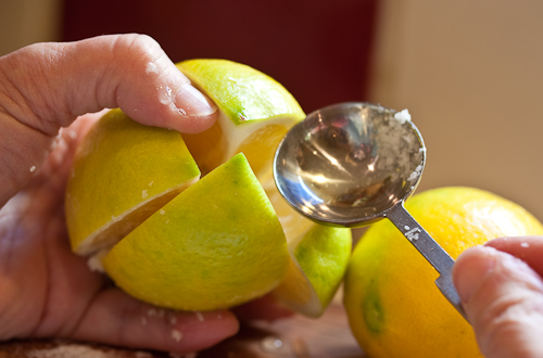 Catch the excess salt and rub it onto the lemon before putting it in the jar